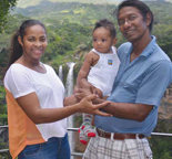 Janet Georges with baby daughter and husband