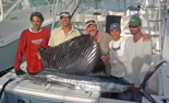 Crew of Kuki with trophy